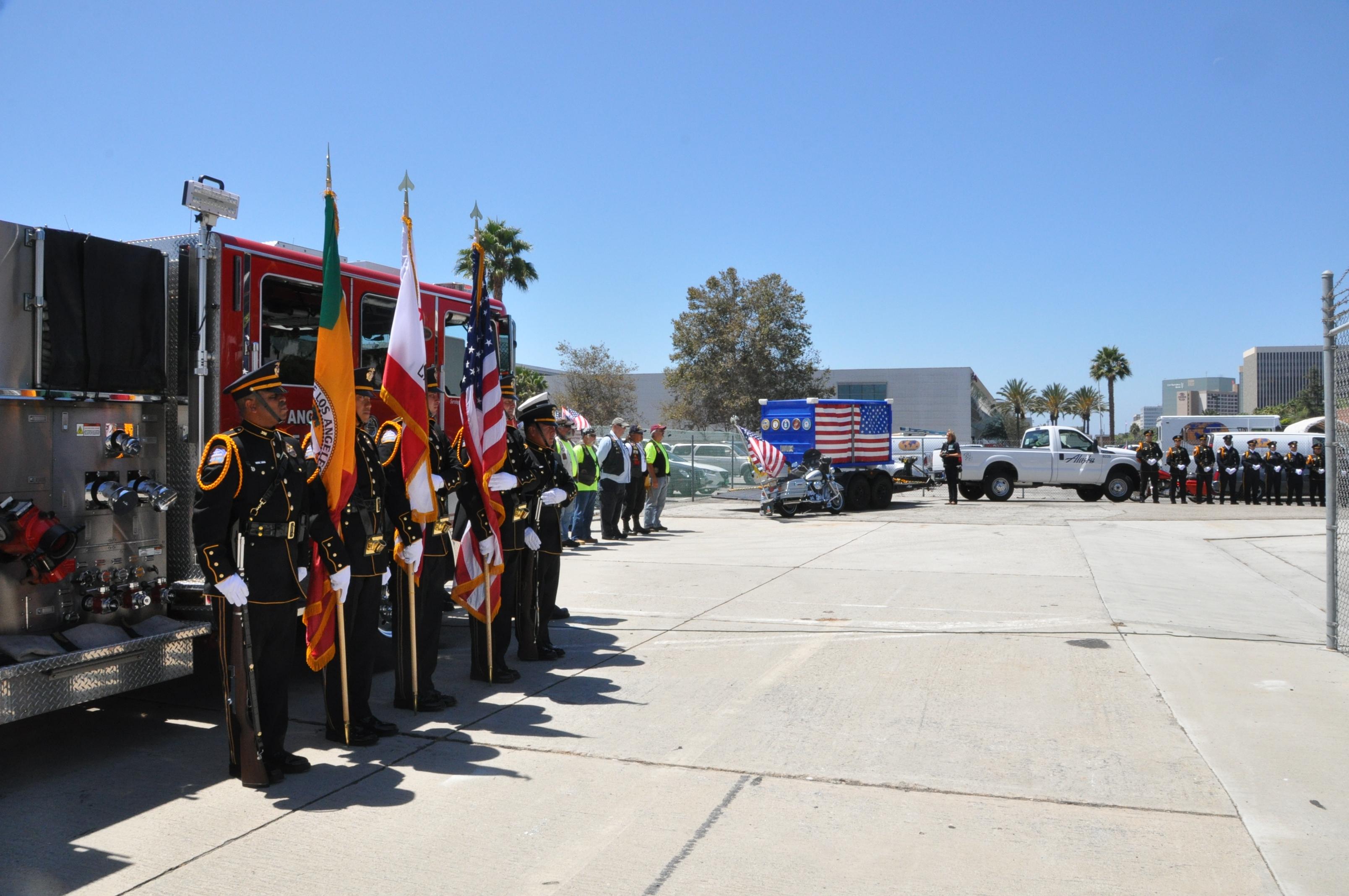 LAWA police honor guard members greet fallen soldier cart