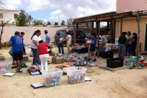 Alaska Airlines employees in Los Cabos divide supplies that were delivered.