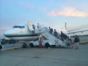 Customers board a relief flight in Mazatlán Sept. 16.