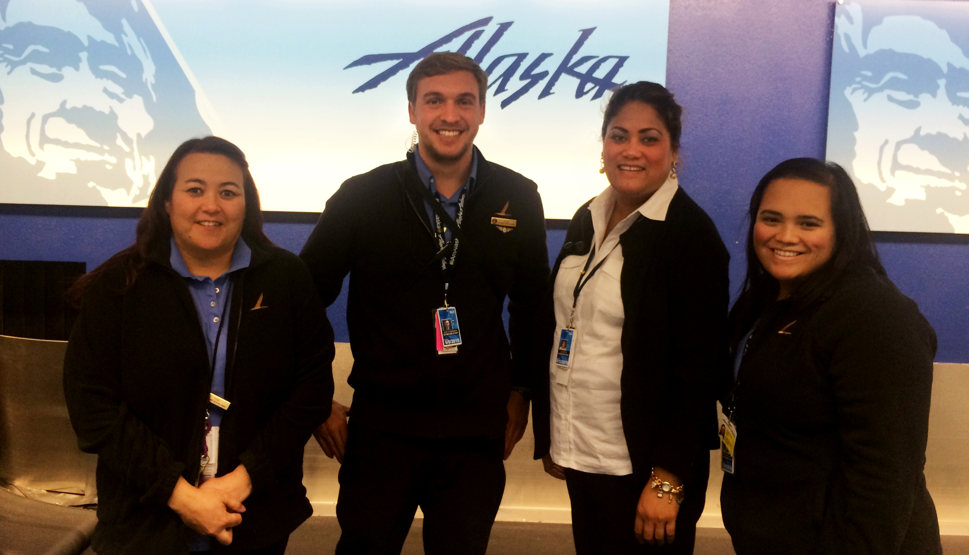 Alaska's Salt Lake City team helped a customer get home as fast as possible during an emergency. Alec Robinson (second from left) was the ticket-counter lead that day.
