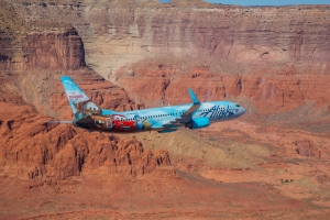 "Alaska's ""Adventure of Disneyland Resort"" flies above Monument Valley."