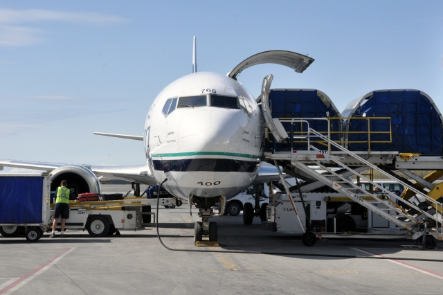 An Alaska Airlines 737-400 Combi – half cargo, half seats for passengers – is loaded in Anchorage, Alaska.
