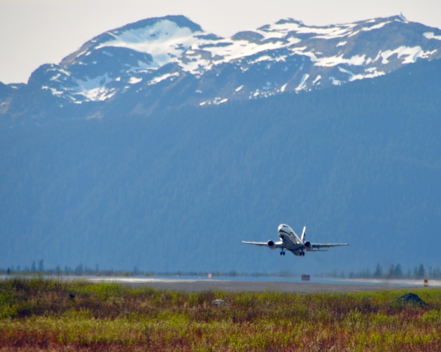 An Alaska Airlines 737 takes off in Cordova, Alaska.