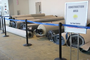 You can find retired portions of the carpet in construction areas near check-in counters.
