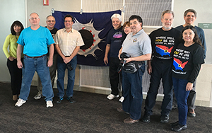 Before Flight 870 departed Anchorage, eclipse chasers gathered with Craig Small's lucky eclipse flag, which has accompanied him on every viewing expedition since 1973. He's seen 31.