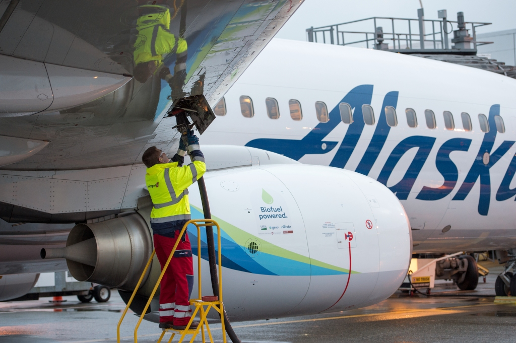 Swissport fuel manager Jarid Svraka fuels an Alaska Airlines flight powered with a 20 percent blend of biofuel made from forest residuals in Sea-Tac Washington on Nov. 14, 2016.