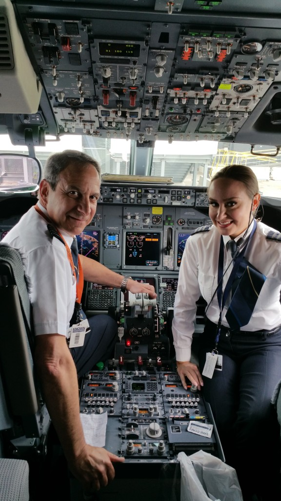 This is a photo of a father-daughter pilot team in the flight deck.