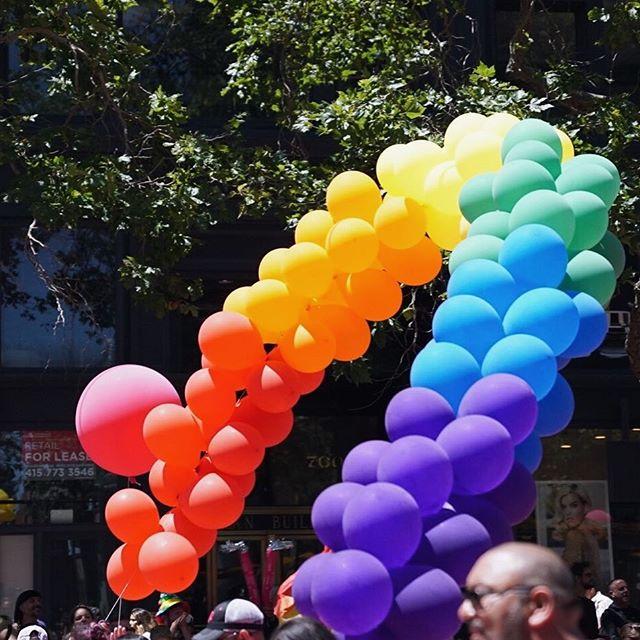Photo of rainbow colored balloons at San Francisco Pride parade