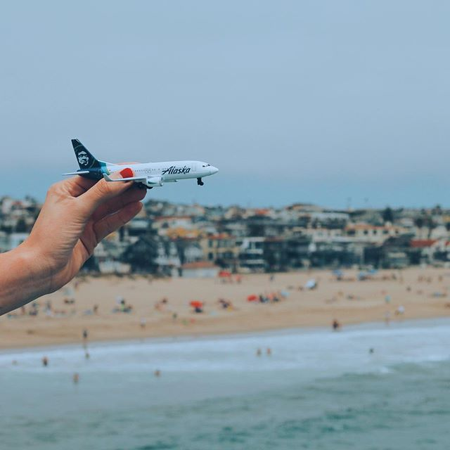 This is a photo of a mini plane with a view of the beach in the background.