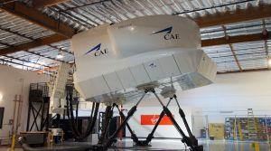 Photo of a Virgin America flight simulator in warehouse.