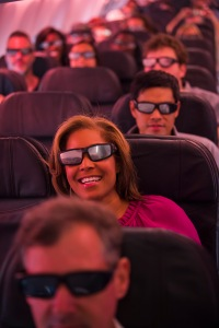 Danielle Nottingham, with CBS news out of Los Angeles, sports some eclipse viewing shades on Alaska Airlines Great American Eclipse Flight.