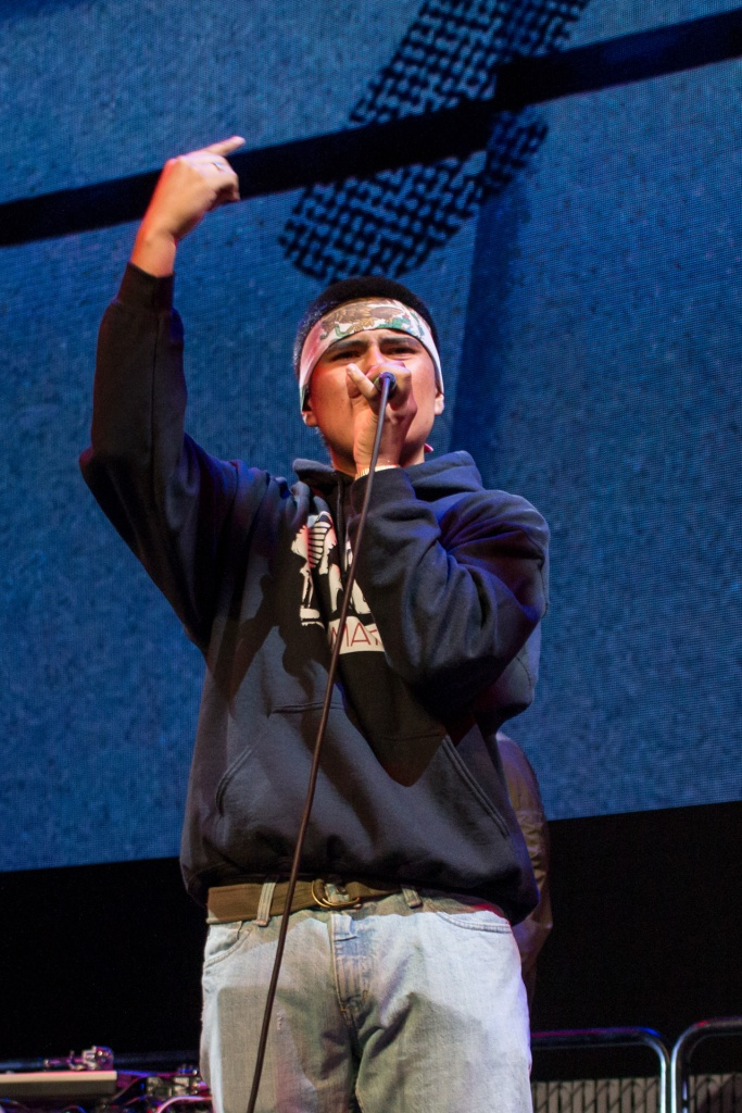 This is a photo of a student rapping on stage as part of the Residency Program's showcase concert.