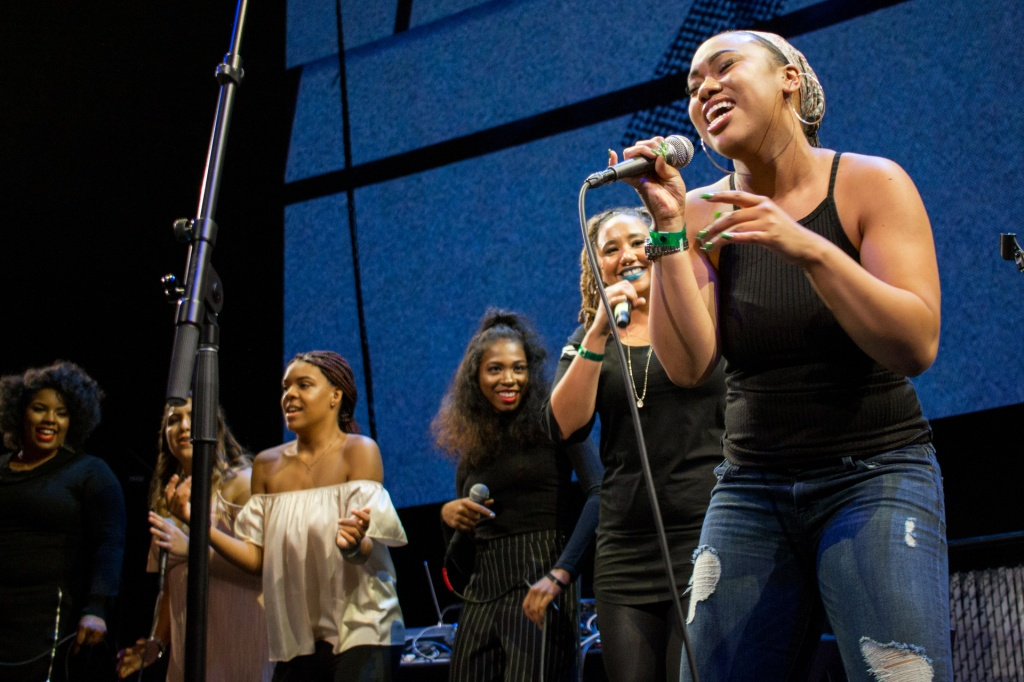 This is a photo of a group of students performing live on stage in the Residency's professional performance.