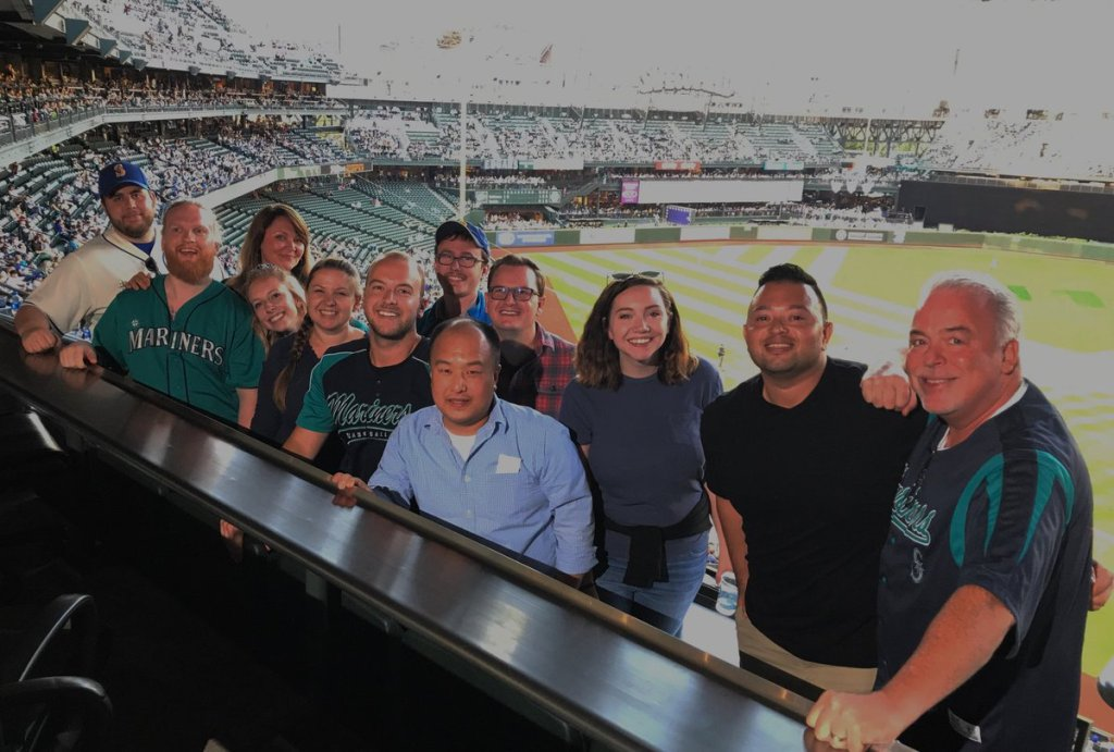This is a photo of the Alaska Airlines social care team wearing Mariners gear. The team is based in Seattle.