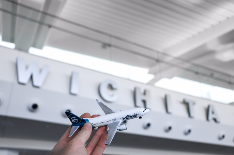 "Photo of a mini plane in front of the word ""Wichita"""