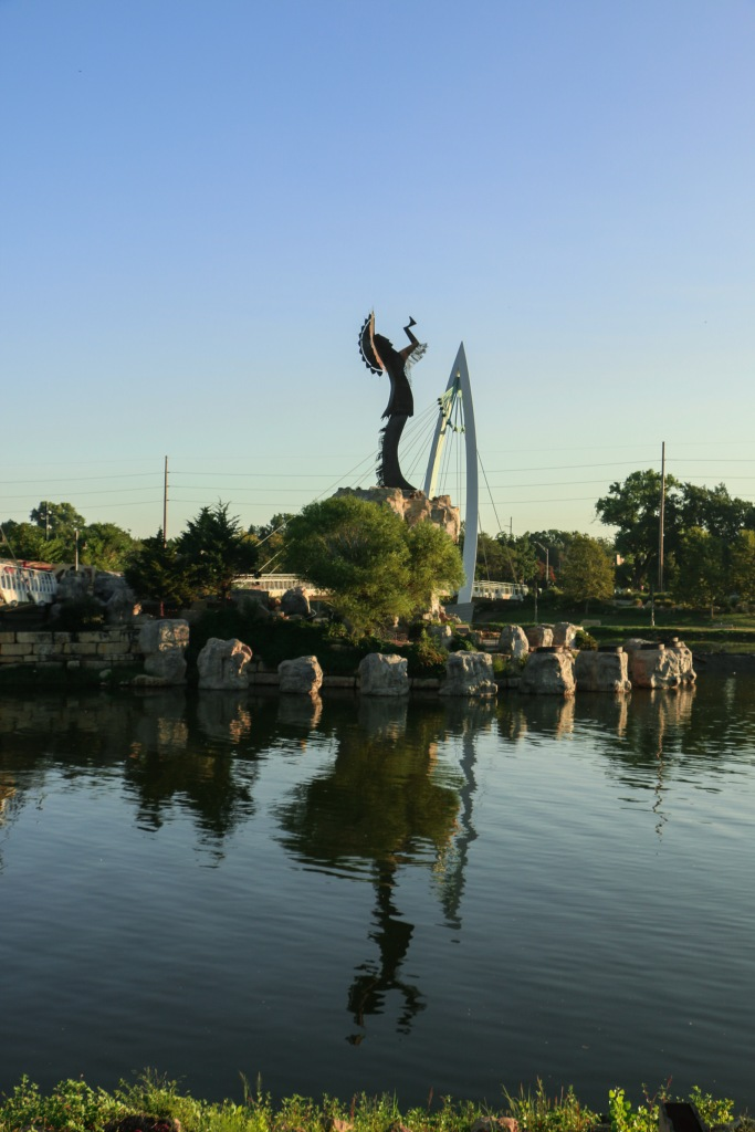 Photo of a Native American statue in the middle of the Arkansas River