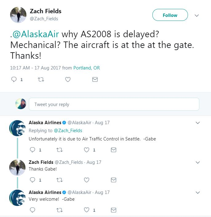 This is a photo of a Twitter interaction between an Alaska Airlines social care agent and a guest, explaining that their flight is delayed due to ATC.