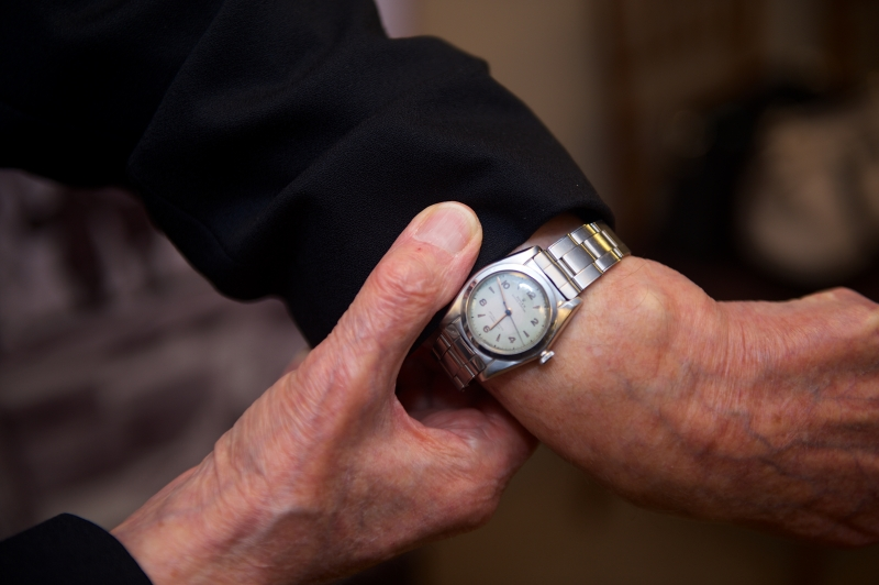 This is a close up photo of a silver Rolex watch on Elgen Long's left arm.