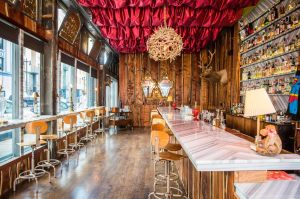 This is a photo of the Bar Biig. It was wooden floors and walls with bright lights and a rustic design.