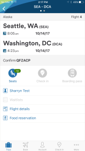 "This is a screenshot of the Alaska Airlines mobile app. It shows a reservation departing Seattle for Washington, D.C. There are several icons below the destination one reads ""Food Reservation"""